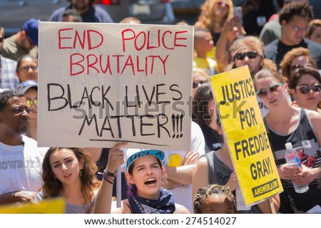Los Angeles, CA, USA - May 02, 2015: Woman holding sign during march against the death of Freddie Gray, a man of Baltimore who was seriously injured in police custody. - stock photo