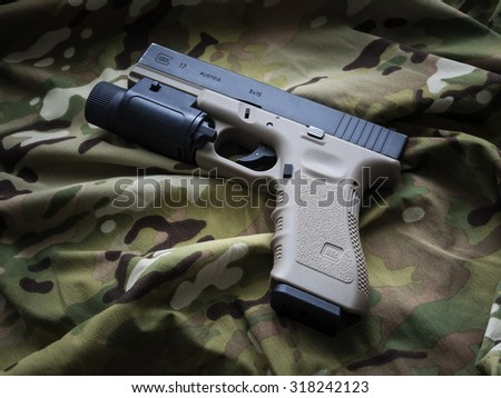 Los Angeles, CA, USA - September 11, 2015: Glock 17 semi-automatic 9x19mm pistol - weapon by law enforcement professionals around the globe. - stock photo
