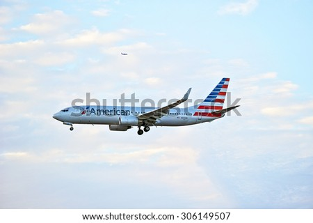 LOS ANGELES/CALIFORNIA - AUG. 6, 2015: American Airlines Boeing 737-823 commercial jet approaches runway to make a landing at Los Angeles International Airport in Los Angeles, California, USA - stock photo