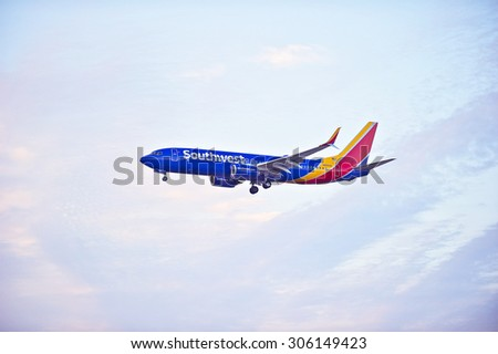 LOS ANGELES/CALIFORNIA - AUG. 6, 2015: Southwest Airlines Boeing 738 commercial jet approaches runway for a landing at Los Angeles International Airport in Los Angeles, California, USA - stock photo