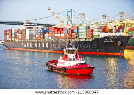 LOS ANGELES/CALIFORNIA - AUGUST 22, 2014: Yang Ming Marine Transport ship departs the Port of Los Angeles, the largest port in USA August 22, 2014 in San Pedro, California USA  - stock photo