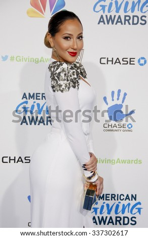 LOS ANGELES, CALIFORNIA - December 7, 2012. Adrienne Bailon at the 2nd Annual American Giving Awards held at the Pasadena Civic Auditorium in Los Angeles.   - stock photo