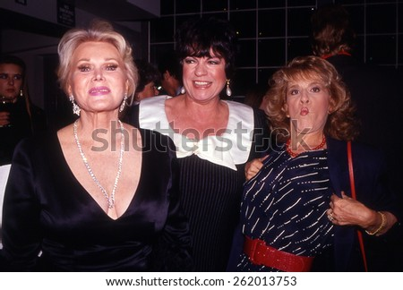 LOS ANGELES, CALIFORNIA - exact date unknown - circa 1990 - Zsa Zsa Gabor, Jo Anne Worley and Ruth Buzzi goofing off at a celebrity charity event - stock photo