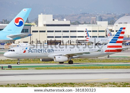 LOS ANGELES/CALIFORNIA - FEB. 21, 2016: American Airlines Airbus 321-231 is taxiing along runway upon arrival to Los Angeles International Airport, Los Angeles, California USA - stock photo