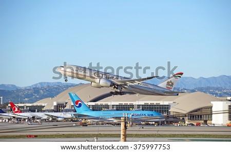 LOS ANGELES/CALIFORNIA - FEB. 7, 2016: Etihad Airways Boeing 777 is airborne as it departs Los Angeles International Airport, Los Angeles, California USA - stock photo