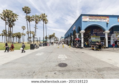 LOS ANGELES, CALIFORNIA - June 20, 2014:  View of Southern California's famously funky Venice Beach boardwalk in the city of Los Angeles, California. - stock photo