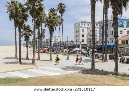 LOS ANGELES, CALIFORNIA - June 20, 2014: View of the popular Venice Beach boardwalk and bike path in Los Angeles, California. - stock photo