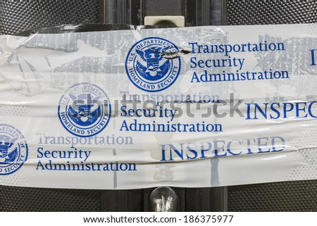 LOS ANGELES, CALIFORNIA - MARCH 24: Suitcase sealed with Transportation Security Administration inspected notification tape. - stock photo