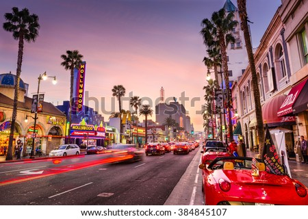 LOS ANGELES, CALIFORNIA - MARCH 1, 2016: Traffic on Hollywood Boulevard at dusk. The theater district is famous tourist attraction. - stock photo