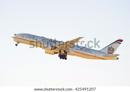 LOS ANGELES/CALIFORNIA - MAY 22, 2016: Etihad Airways Boeing 777-237(LR)  commercial aircraft is airborne as it departs Los Angeles International Airport, Los Angeles, California USA - stock photo