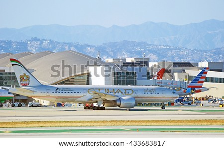 LOS ANGELES/CALIFORNIA - MAY 22, 2016: Etihad Airways Boeing 777-234(LR) commercial aircraft is taxiing along runway before take off Los Angeles International Airport, Los Angeles, California USA  - stock photo
