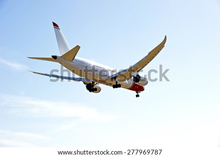 LOS ANGELES/CALIFORNIA - MAY 10, 2015: Norwegian Air commercial jet on approach to runway at Los Angeles International Airport in Los Angeles, California, USA - stock photo