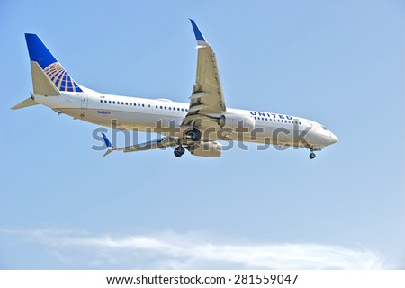 LOS ANGELES/CALIFORNIA - MAY 10, 2015:  United Airlines commercial jet on approach to runway at Los Angeles International Airport in Los Angeles, California, USA - stock photo