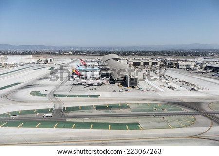 LOS ANGELES, CALIFORNIA - September 11, 2014:  Large planes lined up at the newly renovated Tom Bradley terminal at LAX.   - stock photo