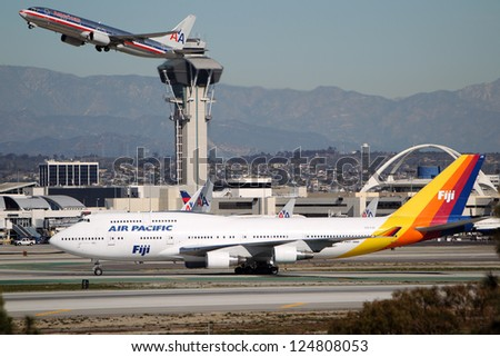 LOS ANGELES, CALIFORNIA, USA - JANUARY 15, 2013 - Air Pacific Fiji Boeing 747-412 takes off at Los Angeles Airport on January 15, 2013. The 400 series is 4% more fuel efficient than other 747's. - stock photo