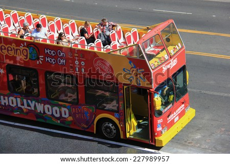 Los Angeles, California, USA - May 19, 2014: A tour bus is taking tourists to travel at Hollywood Boulevard, California. - stock photo