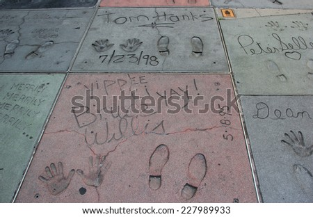 Los Angeles, California, USA - May 19, 2014: Hand and Foot Prints of Movie Stars on the Hollywood Walk of Fame on Hollywood Boulevard in Los Angeles, California - stock photo