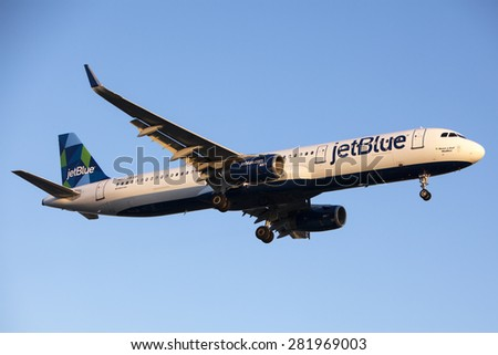 LOS ANGELES, California/USA - MAY 24, 2015. JetBlue Airways Airbus A321-231 lands at Los Angeles Airport (LAX) on May 24, 2015.  - stock photo