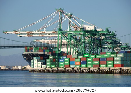 Los Angeles, California, USA - September 25, 2010:  Busy cargo container berth in the congested Los Angeles Harbor.           - stock photo