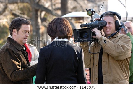 Los Angeles camera man with video gear records an interview. - stock photo