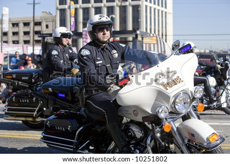 Los Angeles Chinatown, Feb 9th, 2008: Los Angeles Police Department Motocycle officers in the Chinese New Year Golden Dragon Parade. - stock photo