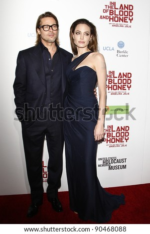"""LOS ANGELES - DEC 8:  Brad Pitt, Angelina Jolie arrives at the """"In the Land of Blood and Honey"""" LA Premiere at ArcLight Cinemas on December 8, 2011 in Los Angeles, CA - stock photo"""