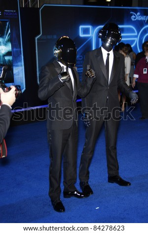 LOS ANGELES - DEC 11: Daft Punk at the world premiere of 'Tron' held at the El Capitan Theatre in Los Angeles, California on December 11, 2010 - stock photo