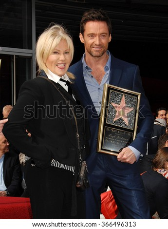 LOS ANGELES - DEC 13 - Deborra-Lee Furness and husband Hugh Jackman arrives at the Hugh Jackman Star On The Hollywood Walk Of Fame Ceremony on December 13, 2012 in Los Angeles, CA              - stock photo