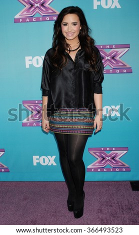 LOS ANGELES - DEC 17 - Demi Lovato arrives at the X Factor Season Finale Press Conference  on December 17, 2012 in Los Angeles, CA              - stock photo