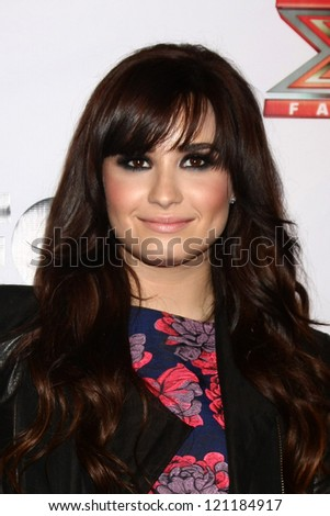 LOS ANGELES - DEC 6:  Demi Lovato arrives to the X Factor 2012 Final Four Party at Rodeo Drive on December 6, 2012 in Beverly Hills, CA - stock photo