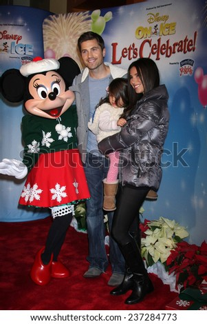 "LOS ANGELES - DEC 11:  Eric Winter, Sebella Winter, Roselyn Sanchez, Minnie Mouse at the ""Disney on Ice"" Red Carpet Reception at the Staples Center on December 11, 2014 in Los Angeles, CA - stock photo"
