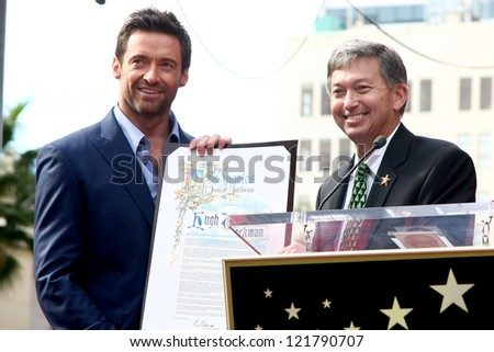 LOS ANGELES - DEC 13:  Hugh Jackman, Leron Gubler at the Hollywood Walk of Fame ceremony for Hugh Jackman at Hollywood Boulevard on December 13, 2012 in Los Angeles, CA - stock photo