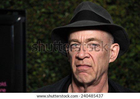 "LOS ANGELES - DEC 15:  JK SIMMONS arrives to the ""Young Adult"" Los Angeles Premiere  on December 15, 2011 in Beverly Hills, CA                 - stock photo"