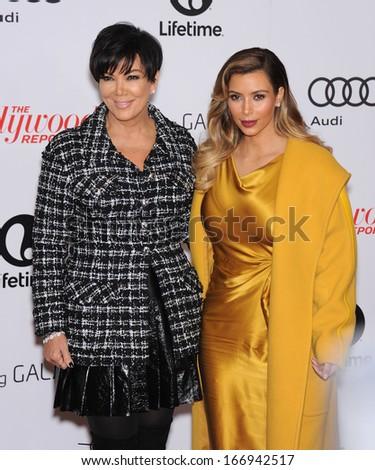 LOS ANGELES - DEC11:  Kris Jenner & Kim Kardashian arrive to Women in Entertainment Breakfast 2013  on December 11, 2013 in Hollywood, CA                 - stock photo