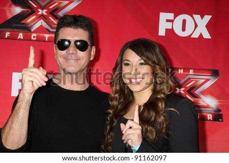 "LOS ANGELES - DEC 19: LA Reid, Chris Rene, Nicole Scherzinger, Josh Krajcik, Paula Abdul, Simon Cowell, Melanie Amaro at the FOX's ""The X Factor"" at CBS Studios on December 19, 2011 in Los Angeles, CA - stock photo"