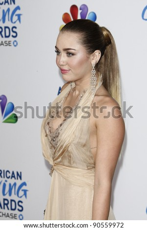 LOS ANGELES - DEC 9:  Miley Cyrus arrives at the 2011 American Giving Awards at Dorothy Chandler Pavilion on December 9, 2011 in Los Angeles, CA - stock photo