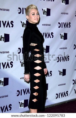 LOS ANGELES - DEC 16:  Miley Cyrus arriving at the VH1 Divas Concert 2012 at Shrine Auditorium on December 16, 2012 in Los Angeles, CA - stock photo
