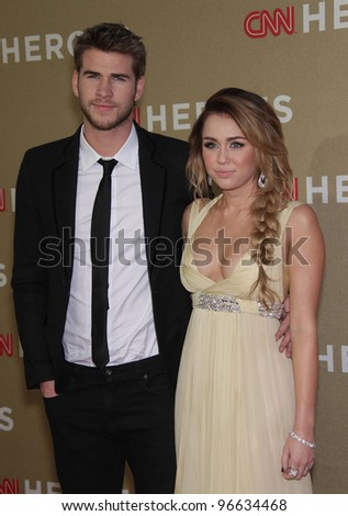 LOS ANGELES - DEC 11:  Miley Cyrus & Liam Hemsworth arrives to the CNN Heroes: All-Star Tribute 2011  on December 11, 2011 in Los Angeles, CA. - stock photo