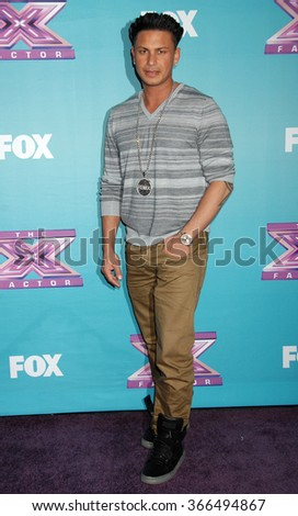 "LOS ANGELES - DEC 19 - Paul ""Pauly D"" DelVecchio arrives at the X Factor 2012 Season Finale Day 1  on December 19, 2012 in Los Angeles, CA              - stock photo"