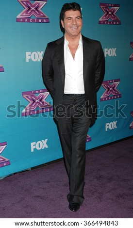 LOS ANGELES - DEC 19 - Simon Cowell arrives at the X Factor 2012 Season Finale Day 1  on December 19, 2012 in Los Angeles, CA              - stock photo