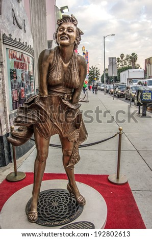 LOS ANGELES - DECEMBER 18, 2013: Hollywood Boulevard and Hollywood museum. In 1958, the Hollywood Walk of Fame was created on this street as a tribute to artists working in the entertainment industry - stock photo