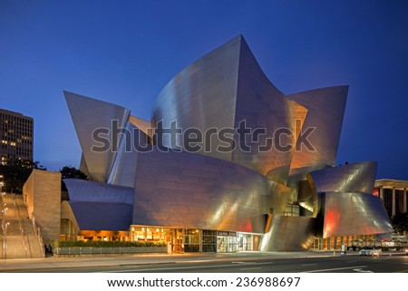 LOS ANGELES - DECEMBER 6: Twilight of Walt Disney Concert Hall in LA, CA on December 6, 2014. The hall was designed by Frank Gehry and is a major component in the Los Angeles Music Center complex. - stock photo