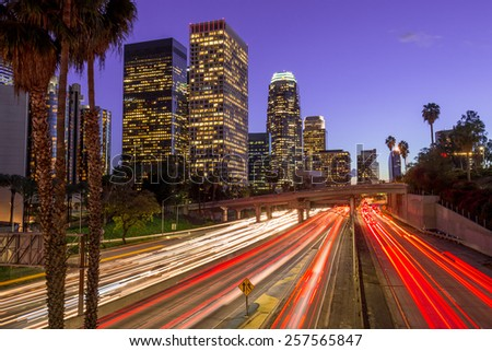 Los Angeles downtown buildings skyline highway traffic long exposure - stock photo