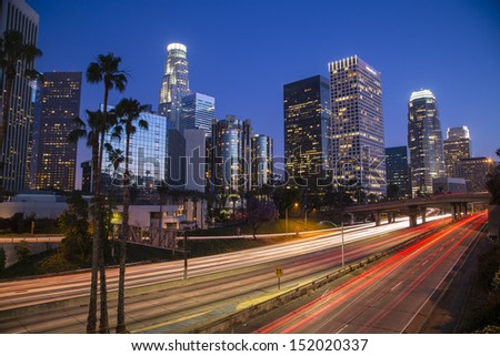 Los Angeles downtown skyline at night time-lapse long exposure - stock photo