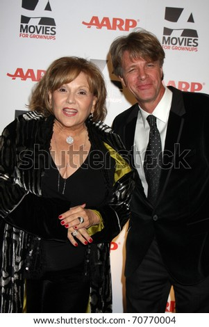 """LOS ANGELES - FEB 7:  Brenda Vacarro & husband arrives at the 2011 AARP """"Movies for Grownups"""" Gala  at Regent Beverly Wilshire Hotel on February 7, 2011 in Beverly Hills, CA - stock photo"""