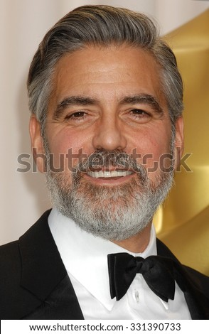 LOS ANGELES - FEB 24 - George Clooney arrives at the 85th Annual Academy Awards Press Room  on February 24, 2013 in Los Angeles, CA              - stock photo