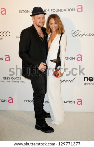 LOS ANGELES - FEB 24:  Joel Madden, Nicole Richie arrive at the Elton John Aids Foundation 21st Academy Awards Viewing Party at the West Hollywood Park on February 24, 2013 in West Hollywood, CA - stock photo
