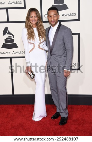LOS ANGELES - FEB 08:  John Legend & Christine Teigen arrives to the Grammy Awards 2015  on February 8, 2015 in Los Angeles, CA                 - stock photo