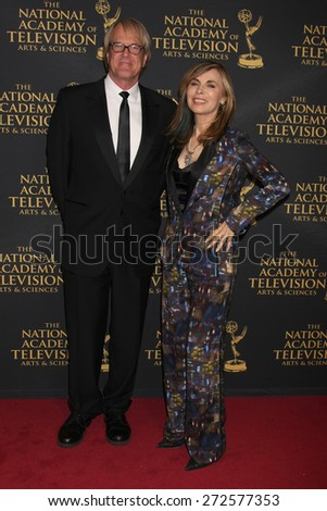 LOS ANGELES - FEB 24:  John Tesh, Lauren Koslow at the Daytime Emmy Creative Arts Awards 2015 at the Universal Hilton Hotel on April 24, 2015 in Los Angeles, CA - stock photo