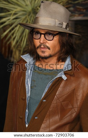LOS ANGELES - FEB 14:  Johnny Depp arrives at the Premiere of 'Rango' held at the Regency Theatre on February 14, 2011 in Westwood, Los Angeles, CA - stock photo